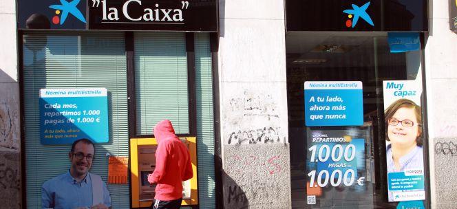 Caixabank solo el 9 de transacciones se hace ya en for Caixa oficina internet